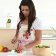 Stock Video: Concentrated asian woman preparing a salad