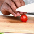 Stock Video: Close up of mcutting cherry tomatoes