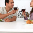 Couple eating at the kitchen — 图库视频影像