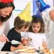 Mother giving cake to her children — Stock Video