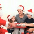 Family opening gift with Santa Claus — Stock Video