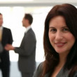 Businesswoman smiling at the camera — Stock Video #15458227