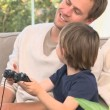 Stock Video: Son and dad playing video games