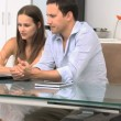 Joyfully couple looking at the laptop sitting at a table — Stock Video