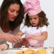 Mother baking cookies with her daughter — Stock Video