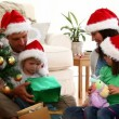 Nice family opening Christmas gifts — Stock Video #15459033