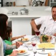 Stock Video: Family having lunch together at table