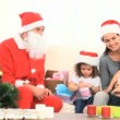 Santa Claus with a family — Vídeo Stock