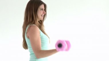 Cute woman doing exercises with dumbbells — Stock Video