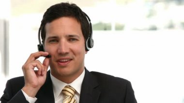 Businessman talking with headphone — Stock Video