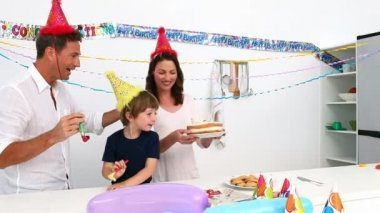 Boy blowing out candles on his birthday cake — Vídeo de stock