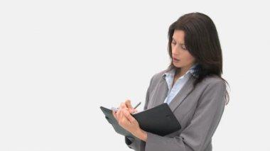 Podnikatelka psaní na její agendy — Stock video
