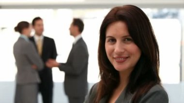 Businesswoman smiling at the camera — Stock Video