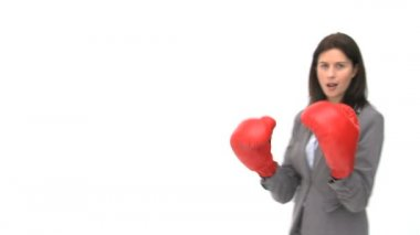Smiling businesswoman with boxing gloves — Stockvideo