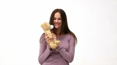 Happy woman playing with a teddy bear — Stock Video