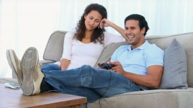 Desperate woman being bored while her boyfriend is playing a video game — Stockvideo