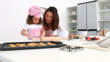 Adorable girl baking with her mother — Stock Video