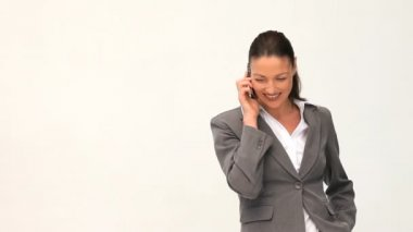 Smilling and pretty businesswoman phoning — Stock Video