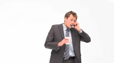 Businessman phoning while he is drinking coffee — Stock Video