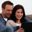 Couple speaking together on the sofa - Stock Photo