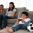 Cute little boy playing video games and parents enjoying watching — Stock Video #15462481