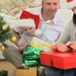 Joyful family opening Christmas gift — Stock Video