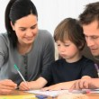 Stock Video: Parents drawing with their son