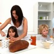 Stock Video: Cute family enjoying breakfast together