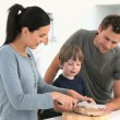 Stock Video: Adorable family cutting bread