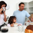 Cute family enjoying breakfast together — Stock Video #15465941
