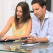Stock Video: Lovely couple buying on internet with credit card