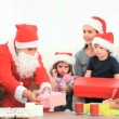 Santa Claus offering Christmas present to the mother — Vídeo Stock