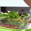Woman preparing a salad — Vídeo de stock #15466397