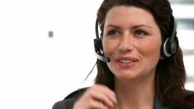 Woman talking on the headphone — Stock Video