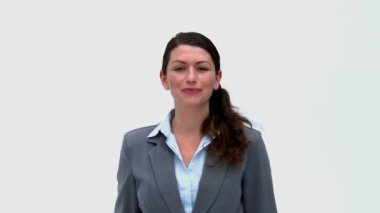 Businesswoman in front of the camera showing ok sign — Vídeo Stock