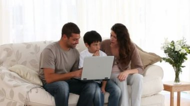 Family playing at a computer — Video Stock