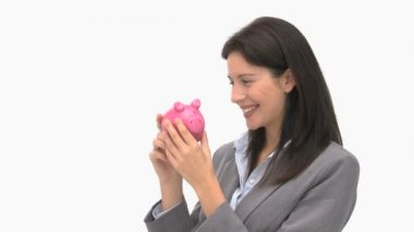 Businesswoman holding a piggy bank — Stock Video #15461783