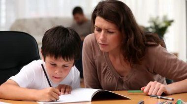 Mum doing homework with her son — Stock Video
