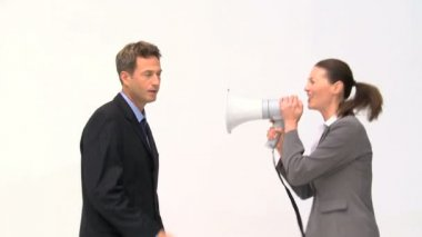 Woman shouting megaphone on a man — Stock Video