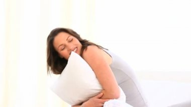 Happy woman hugging a pillow — Stock Video