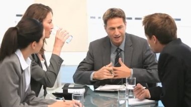 Businesspeople having a discussion during a meeting — Stock Video