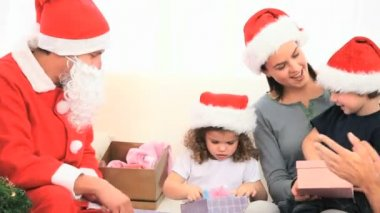 Santa Claus looking at children with their gifts — Stock Video