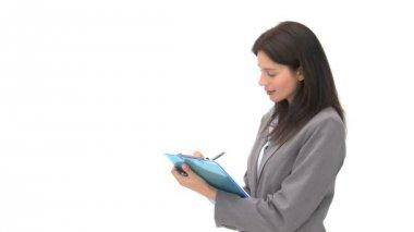 彼女はノートに書いてビジネスマンの笑みを浮かべてください。 — ストックビデオ