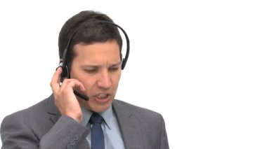 Angry businessman on the phone with earpiece — Stock Video