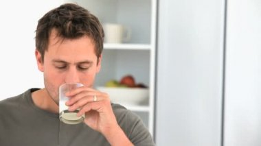 Handsome man drinking a glass of milk — Stock Video
