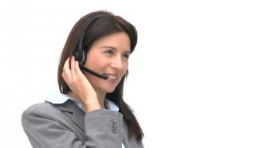 Businesswoman talking on a headset — Vídeo Stock
