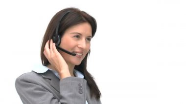 Businesswoman talking on a headset — Stockvideo