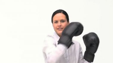 Smiling businesswoman boxing towards the camera — Stock Video