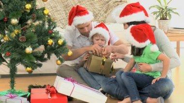 Joyful family opening Christmas gift — Stock Video