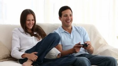 Man playing video games with his girlfriend — Stock Video
